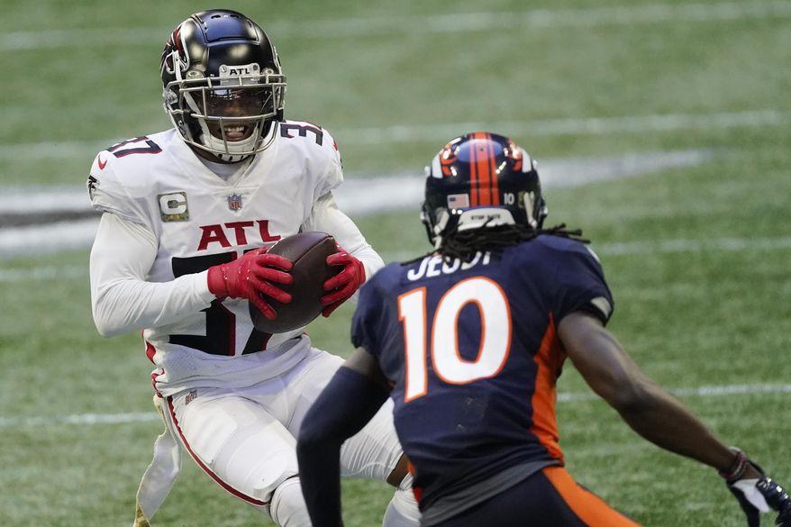 Atlanta Falcons free safety Ricardo Allen (37) intercepts the pass behind Denver Broncos wide receiver Jerry Jeudy (10) during the second half of an NFL football game, Sunday, Nov. 8, 2020, in Atlanta. (AP Photo/John Bazemore)