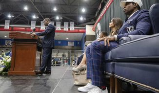 Jackson State University interim president Thomas Hudson, left, speaks during the introductory press conference for Deion Sanders, right, where he was named the head coach of the Jackson State NCAA college football team, Monday, Sept. 21, 2020, in Jackson, Miss. (Eric Shelton/The Clarion-Ledger via AP)