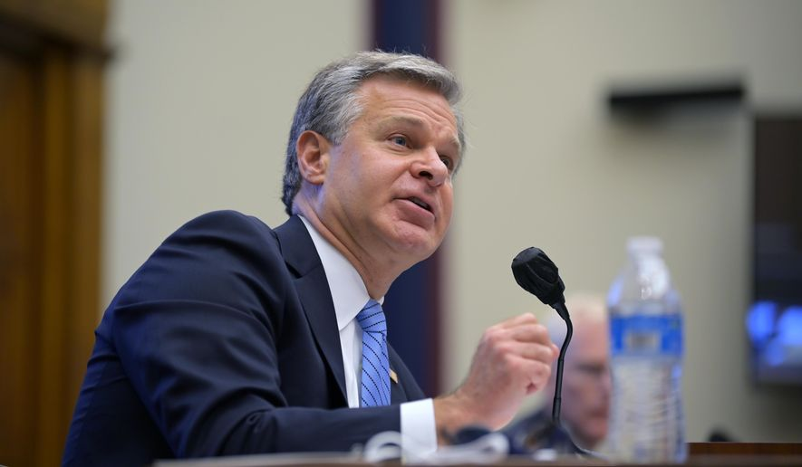 In this Sept. 17, 2020, file photo Federal Bureau of Investigation Director Christopher Wray testifies before a House Committee on Homeland Security hearing on Capitol Hill Washington. (John McDonnell/The Washington Post via AP, Pool, File)