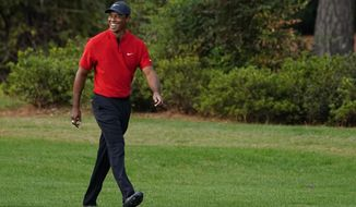 Tiger Woods walks up the 17th fairway during the final round of the Masters golf tournament Sunday, Nov. 15, 2020, in Augusta, Ga. (AP Photo/Matt Slocum)