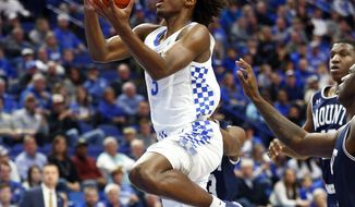 FILE - In this Friday, Nov. 22, 2019 file photo, Kentucky's Tyrese Maxey, left, shoots near Mount St. Mary's Malik Jefferson during the first half of an NCAA college basketball game in Lexington, Ky. The Philadelphia 76ers selected Kentucky guard Tyrese Maxey with the 21st pick of the NBA draft, Wednesday, Nov. 18, 2020, the first selection under the new regime led by president Daryl Morey. (AP Photo/James Crisp, File)