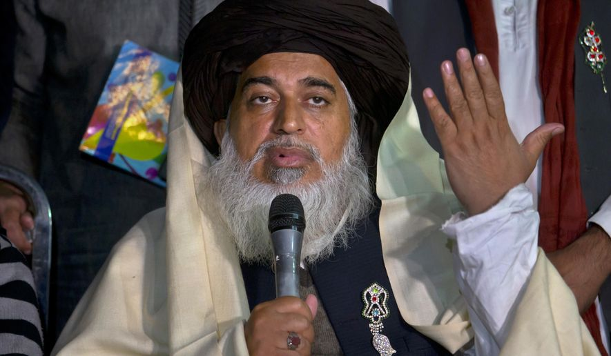FILE - In this Nov. 26, 2017 file photo, Khadim Hussein Rizvi, head of 'Tehreek-e-Labaik Pakistan, a religious political party, speaks during a press conference in Islamabad, Pakistan. Rizvi, a radical religious cleric, who led tens of thousands in anti-France around the country, died Thursday, Nov. 19, 2020. His spokesman and a doctor at the hospital where Rizvi died said he was suffering from COVID-like symptoms but was not tested for the virus. (AP Photo/Anjum Naveed, File)