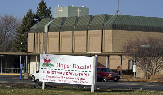 Drive-thru Christmas plans are displayed at Hope Church, Thursday, Nov. 19, 2020, in Richfield, Minn. Minnesota Gov. Tim Walz ordered a four-week shutdown of celebrations and receptions, bars, restaurants, entertainment venues and fitness clubs beginning Friday at midnight to slow the Covid-19 pandemic. (AP Photo/Jim Mone)