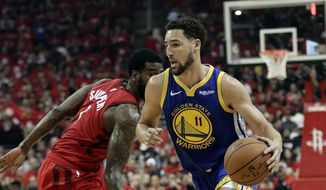 In this May 10, 2019, file photo, Golden State Warriors' Klay Thompson (11) drives past Houston Rockets' Iman Shumpert during the first half of Game 6 of a second-round NBA basketball playoff series in Houston. The Warriors said Thursday, Nov. 19, 2020, that Thompson has suffered a torn right Achilles tendon and is expected to miss the upcoming season.  Thompson was injured during a pickup game in Southern California the day before.  (AP Photo/Eric Gay, File) **FILE**
