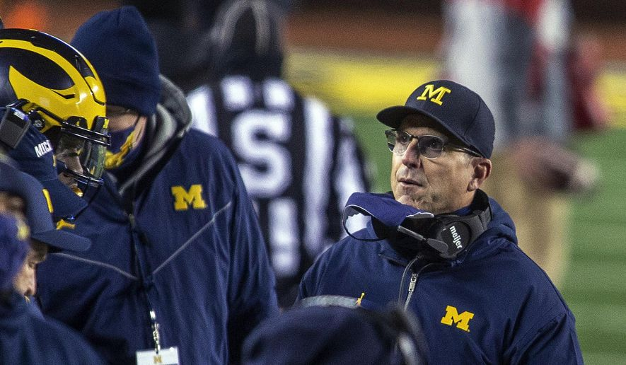 Michigan coach Jim Harbaugh stands on the sideline during the first quarter of the team's NCAA college football game against Wisconsin in Ann Arbor, Mich., Saturday, Nov. 14, 2020. (AP Photo/Tony Ding) **FILE**