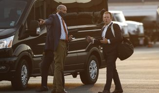 Andrew Giuliani (right), special assistant to President Donald Trump, walks to a van after stepping off Air Force One at Morristown Municipal Airport in Morristown, N.J., on July 24, 2020. (AP Photo/Patrick Semansky) **FILE**