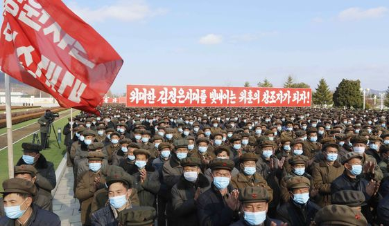 Members of North Korea's military divisions attend a meeting to pay respect to late leaders Kim Il Sung and Kim Jong Il at the Kumsusan Palace of the Sun in Pyongyang, North Korea, Friday, Nov. 20, 2020. (AP Photo/Jon Chol Jin)