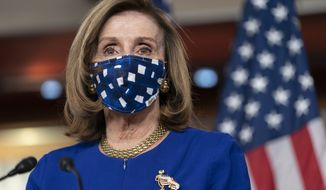 House Speaker Nancy Pelosi, of Calif., speaks during her weekly briefing, Friday, Nov. 20, 2020, in Washington. (AP Photo/Jacquelyn Martin)