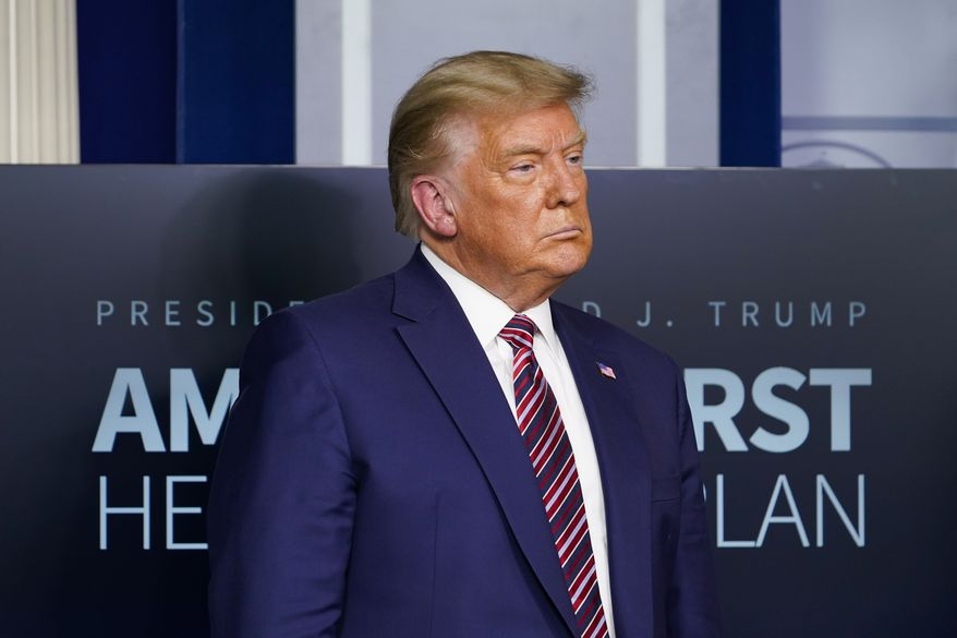 President Donald Trump listens during a news conference in the briefing room at the White House in Washington, Friday, Nov. 20, 2020. (AP Photo/Susan Walsh)