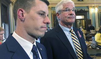 FILE - In this May 24, 2019 file photo, Republican House Speaker Lee Chatfield, left, and Republican Senate Majority Leader Mike Shirkey speak with reporters at the Capitol in Lansing, Mich.  Chatfield and Shirkey are headed to the White House on Friday as President Donald Trump made an extraordinary and sure-to-be futile attempt to block Joe Biden's victory in the battleground state and subvert the results of the 2020 presidential election. (AP Photo/David Eggert, File)
