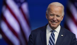 FILE - In this Nov. 10, 2020, file photo President-elect Joe Biden smiles as he speaks at The Queen theater in Wilmington, Del. President-elect Biden turns 78 on Friday, Nov. 20. (AP Photo/Carolyn Kaster, File)