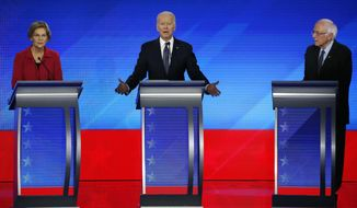 FILE - In this Feb. 7, 2020, file photo Democratic presidential candidate former Vice President Joe Biden, center, speaks as Sen. Elizabeth Warren, D-Mass., left, and Sen. Bernie Sanders, I-Vt., listen during a Democratic presidential primary debate hosted by ABC News, Apple News, and WMUR-TV at Saint Anselm College in Manchester, N.H. Sanders and Warren, the faces of the Democratic Party's far-left wing, are at risk of being excluded from the senior ranks of President-elect Biden's administration as the incoming president balances the demands of his party's progressive base against the political realities of a narrowly divided Senate. (AP Photo/Elise Amendola, File)