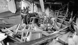 FILE - In this file photo dated Nov. 22, 1974, an interior view showing the damage caused by a bomb at the Mulberry Bush pub in Birmingham, England, one of two public houses bombed late on November 21.  It is announced Wednesday Nov. 18, 2020, that police have arrested a 65-year old man in Northern Ireland in connection with the deaths of 21 people in the 1974 pub bombings in Birmingham, England.(AP Photo/Peter Kemp, FILE)