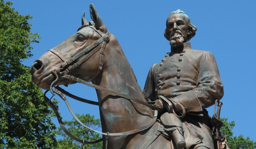 In this Aug. 18, 2017, file photo, a statue of Confederate Gen. Nathan Bedford Forrest sits in a park in Memphis, Tenn. Lawyers in Tennessee are seeking a judge's approval for the disinterment of Confederate general and slave trader Nathan Bedford Forrest's remains from his burial plot in a Memphis park, Friday, Nov. 20, 2020. (AP Photo/Adrian Sainz, File)