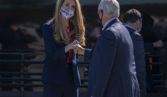 Vice President Mike Pence is greeted by U.S. Senator Kelley Loeffler as he arrives at Dobbins Air Reserve Base in Marietta, Ga., Friday, Nov. 20, 2020. (Alyssa Pointer /Atlanta Journal-Constitution via AP)