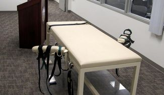 This Oct. 20, 2011 file photo shows the execution chamber at the Idaho Maximum Security Institution as Security Institution Warden Randy Blades look on in Boise, Idaho. Prosecutors in New York are seeking the death penalty against an MS-13 gang leader charged in a string of brutal murders. (AP Photo/Jessie L. Bonner, File)  **FILE**