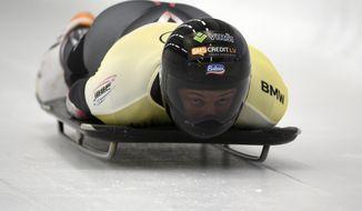 Martins Dukurs of Latvia speeds down the track in the men's Skeleton World Cup race in Sigulda, Latvia, Friday, Nov. 20, 2020. Dukurs won the event. (AP Photo/Roman Koksarov)