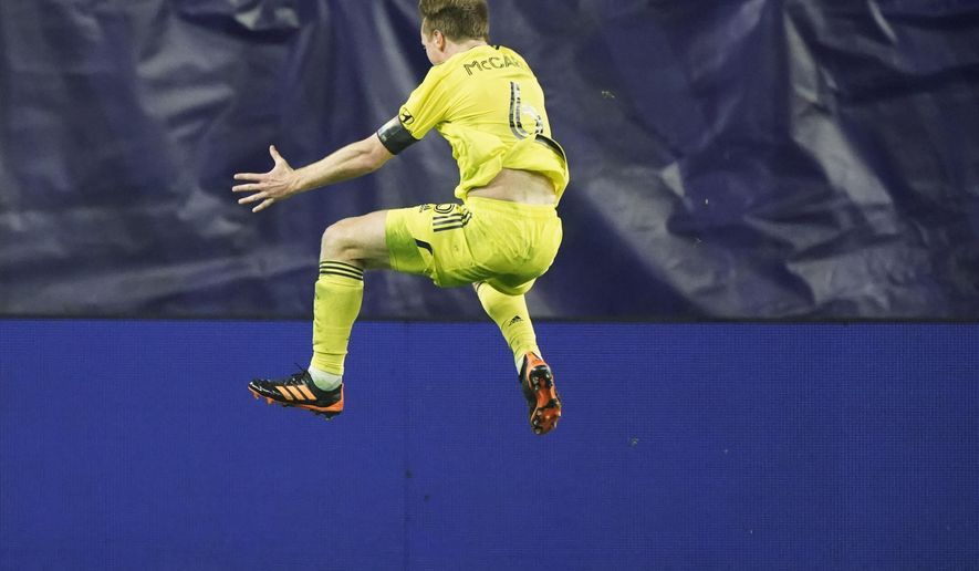 Nashville SC midfielder Dax McCarty (6) celebrates after scoring a goal against Inter Miami during the second half of an MLS soccer playoff match Friday, Nov. 20, 2020, in Nashville, Tenn. (AP Photo/Mark Humphrey)