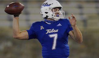 Tulsa quarterback Davis Brin throws a pass against Tulane during the second half of an NCAA college football game in Tulsa, Okla., Thursday, Nov. 19, 2020. (AP Photo/Sue Ogrocki)