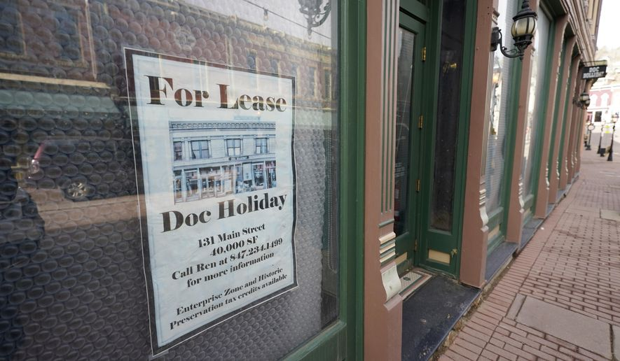 A lease sign hangs on the window of a shuttered casino along Main Street Wednesday, Nov. 18, 2020, in the gaming town of Central City, Colo. The building has been vacant for several years since the casino's closure. (AP Photo/David Zalubowski)