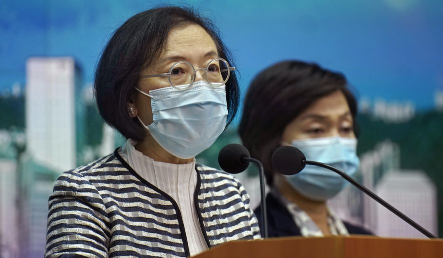 Secretary for Food and Health Sophia Chan listens to questions during a news conference in Hong Kong Friday, Nov. 20, 2020. (AP Photo/Vincent Yu)