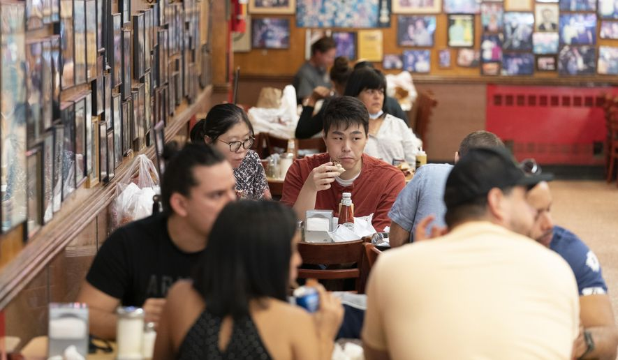 In this Sept. 30, 2020 file photo, customers have lunch at Katz's Delicatessen in New York. New York Mayor Bill de Blasio said Thursday, Nov. 19, 2020, that indoor restaurant service will likely shut down within a week or two to curb the spread of the coronavirus. (AP Photo/Mary Altaffer, File)
