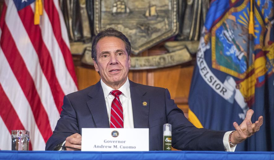 """In this Wednesday, Nov. 18, 2020 photo provided by the Office of Governor Andrew M. Cuomo, Gov. Cuomo holds a press briefing on the coronavirus in the Red Room at the State Capitol in Albany, N.Y. During the news conference, Cuomo predicted a """"tremendous spike"""" in COVID-19 cases after Thanksgiving as he pleaded with people not to be lulled into a false sense of safety over the holiday. (Darren McGee/Office of Governor Andrew M. Cuomo via AP)"""
