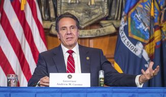 "In this Wednesday, Nov. 18, 2020 photo provided by the Office of Governor Andrew M. Cuomo, Gov. Cuomo holds a press briefing on the coronavirus in the Red Room at the State Capitol in Albany, N.Y. During the news conference, Cuomo predicted a ""tremendous spike"" in COVID-19 cases after Thanksgiving as he pleaded with people not to be lulled into a false sense of safety over the holiday. (Darren McGee/Office of Governor Andrew M. Cuomo via AP)"