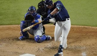 Tampa Bay Rays' Hunter Renfroe hits a home run against the Los Angeles Dodgers during the fifth inning in Game 4 of the baseball World Series Saturday, Oct. 24, 2020, in Arlington, Texas. (AP Photo/Sue Ogrocki)