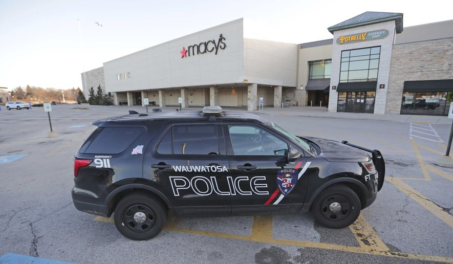 A Wauwatosa police vehicle sits outside Macy's near the entrance to Mayfair Mall on Saturday, Nov. 21, 2020, in Wauwatosa, Wis. (Mike De Sisti/Milwaukee Journal-Sentinel via AP)