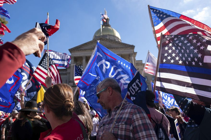 Supporters of President Donald Trump rally outside of the Georgia State Capitol in Atlanta on Saturday, Nov. 21, 2020. (AP Photo/Ben Gray)