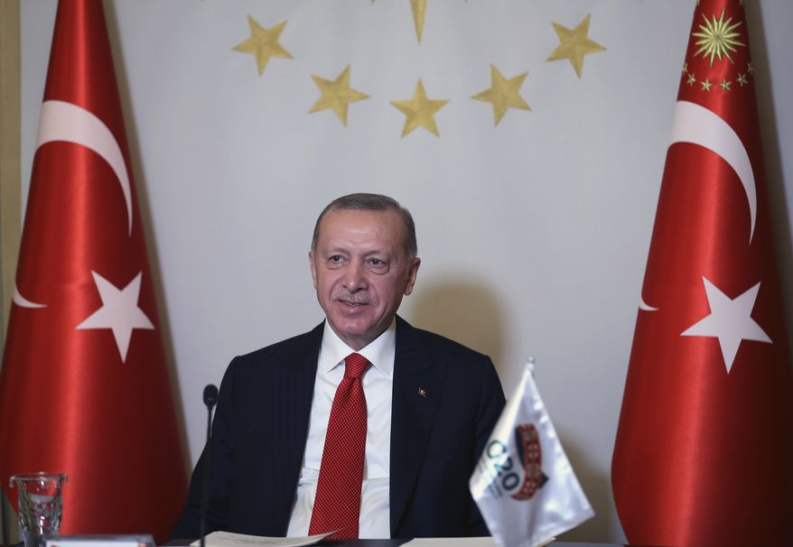 In this file photo, Turkey's President Recep Tayyip Erdogan addresses the leaders of the G20 Leaders' Summit with an introductory video message from his Vahdettin Pavilion, in Istanbul, Saturday, Nov. 21, 2020. Turkey has recorded its highest daily number of new COVID-19 patients Saturday as the country's first weekend curfew since June came into force. (Turkish Presidency via AP, Pool)  **FILE**
