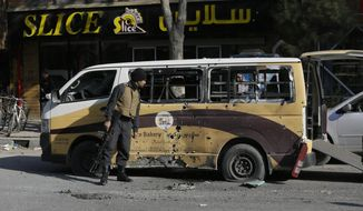 Afghan security checks a car destroyed in a rocket attack in Kabul, Afghanistan,Saturday, Nov. 21, 2020. Multiple rockets were fired around Kabul residential areas Saturday, killing several and wounding dozens of people. (AP Photo/Mariam Zuhaib)