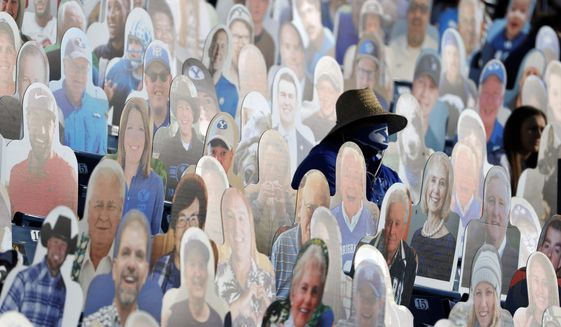 A BYU fans sits among the cardboard fan cutouts during an NCAA college football game against North Alabama, Saturday, Nov. 21, 2020, in Provo, Utah. (AP Photo/Jeff Swinger, Pool)