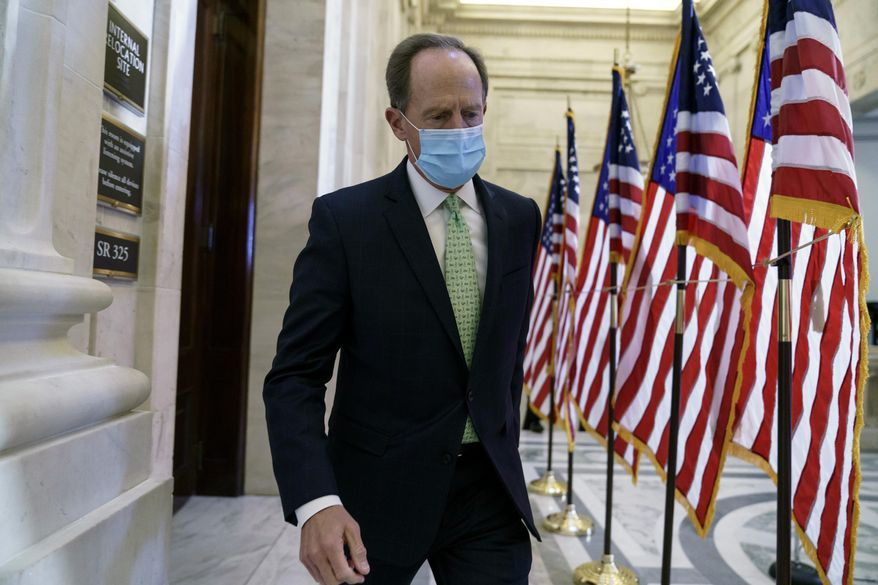 Sen. Pat Toomey, R-Pa., departs after the Republican Conference held leadership elections, on Capitol Hill in Washington, Tuesday, Nov. 10, 2020. (AP Photo/J. Scott Applewhite)