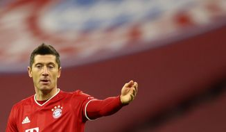 Bayern's Robert Lewandowski reacts during the German Bundesliga soccer match between FC Bayern Munich and SV Werder Bremen in Munich, Germany, Saturday, Nov. 21, 2020. (AP Photo/Matthias Schrader)