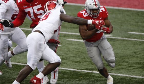 Ohio State running back Master Teague, right, cuts up field as Indiana defensive lineman Jonathan King tries to make the tackle during the second half of an NCAA college football game Saturday, Nov. 21, 2020, in Columbus, Ohio. Ohio State beat Indiana 42-35. (AP Photo/Jay LaPrete)