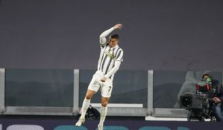Juventus' Cristiano Ronaldo celebrates after scoring his side's second goal during the Serie A soccer match between Juventus and Cagliari at the Allianz stadium, in Turin, Italy, Saturday, Nov. 21, 2020. (AP Photo/Antonio Calanni)
