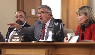 Wisconsin state Rep. John Nygren, R-Marinette, co-chair of the Joint Committee on Finance, has faulted Gov. Tony Evers' administration for the slow pace at which it has processed a surge of unemployment insurance claims during the pandemic. He is seen here during a public hearing at the State Capitol on Dec. 3, 2018 in Madison, Wis. (Coburn Dukehart/Wisconsin Watch via AP)