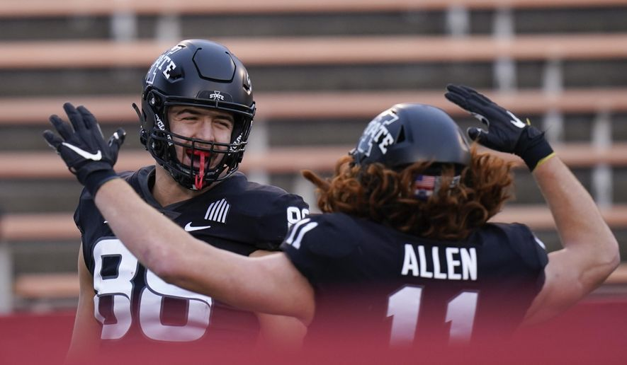 Iowa State tight end Charlie Kolar, left, celebrates with teammate Chase Allen, right, after catching a 6-yard touchdown pass during the first half of an NCAA college football game against Kansas State, Saturday, Nov. 21, 2020, in Ames, Iowa. (AP Photo/Charlie Neibergall)