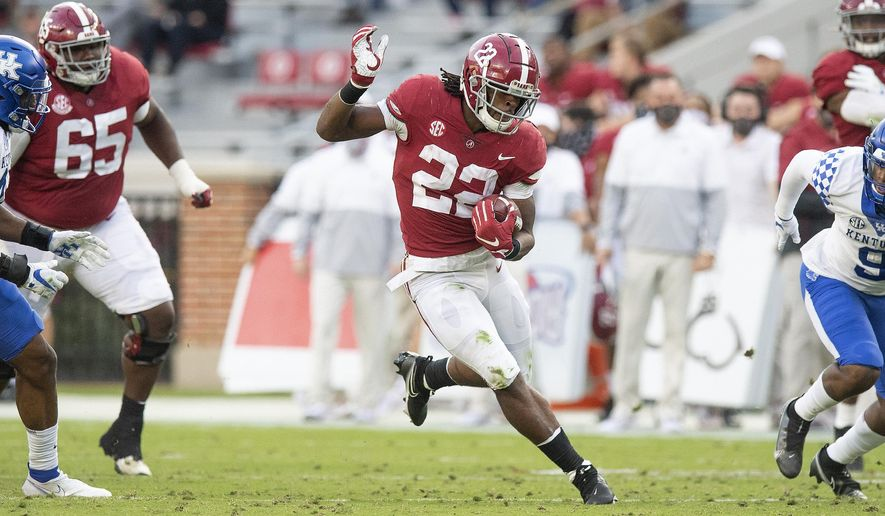 Alabama running back Najee Harris (22) breaks free for a long touchdown run against Kentucky during an NCAA college football game Saturday, Nov. 21, 2020, in Tuscaloosa, Ala. (Mickey Welsh/The Montgomery Advertiser via AP)