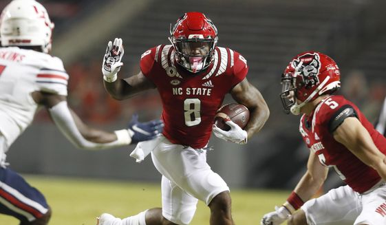 North Carolina State's Ricky Person Jr. (8) looks for running room against Liberty during the first half of an NCAA college football game Saturday, Nov. 21, 2020, in Raleigh, N.C. (Ethan Hyman/The News & Observer via AP, Pool)