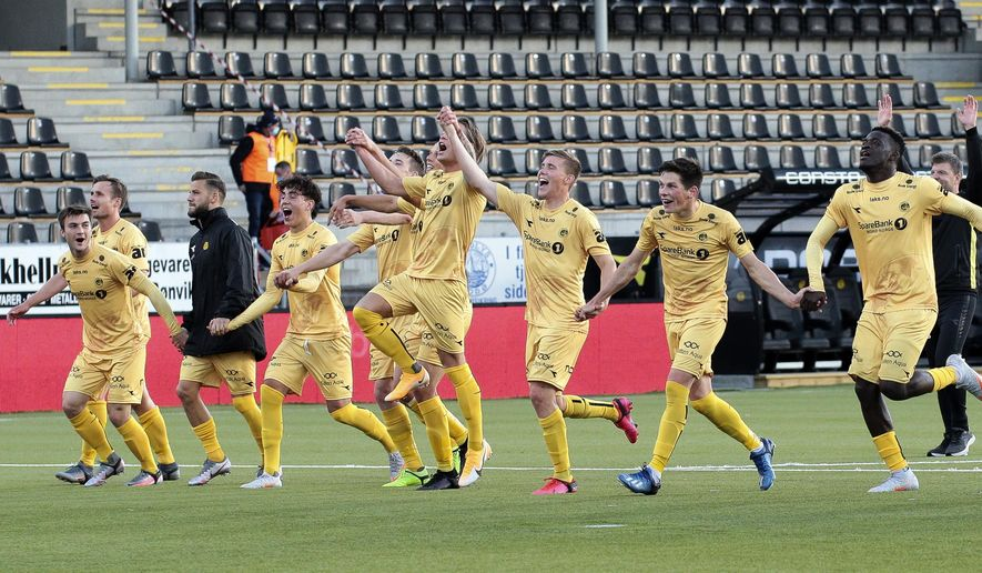 FILE - In this Aug. 27, 2020 file photo, Bodo/Glimt celebrate after the qualifying match for the Europa League between Bodo/Glimt and Kauno Zalgiris at Aspmyra Stadium in Bodo, Norway. Norway is about to get a new soccer champion. Bodo/Glimt needs just a point from its trip to Stromsgodset on Sunday, Nov. 22 to clinch the first top-flight title in its 104-year history and become the most northerly club to be Norwegian champion. (Mats Torbergsen/NTB via AP)