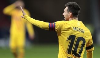 Barcelona's Lionel Messi gestures during the Spanish La Liga soccer match between Atletico Madrid and FC Barcelona at the Wanda Metropolitano stadium in Madrid, Spain, Saturday, Nov. 21, 2020. (AP Photo/Bernat Armangue)
