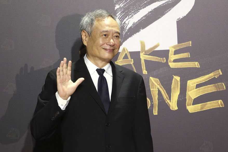 Taiwanese director Ang Lee arrives at the 57th Golden Horse Awards in Taipei, Taiwan, Saturday, Nov. 21, 2020. Lee is a guest at this year's Golden Horse Awards -one of the Chinese-language film industry's biggest annual events. (AP Photo/Chiang Ying-ying)