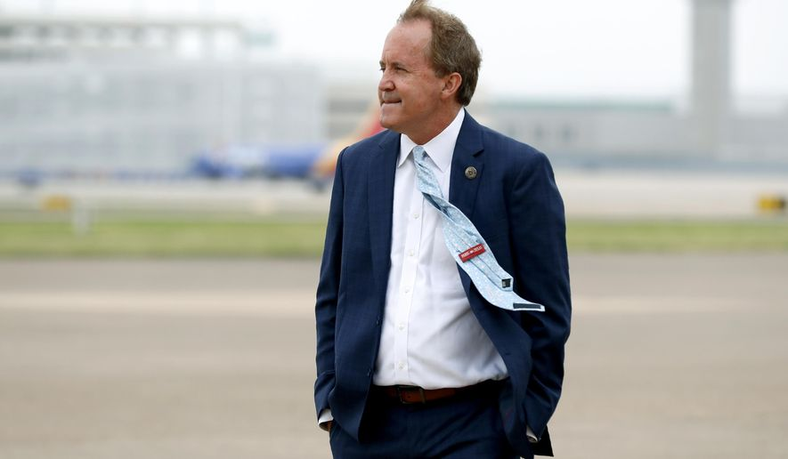 FILE - In this June 28, 2020, file photo, Texas Attorney General Ken Paxton waits on the flight line for the arrival of Vice President Mike Pence at Love Field in Dallas.  Paxton had an extramarital affair with a woman whom he later recommended for a job with the wealthy donor now at the center of criminal allegations against him, according to two people who said Paxton told them about the relationship. (AP Photo/Tony Gutierrez, File)