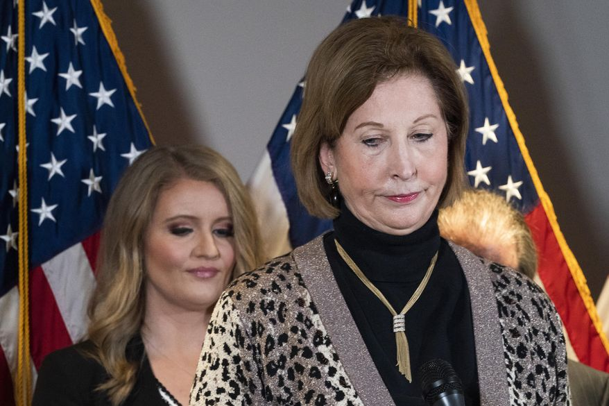 Members of President Donald Trump's legal team, Sidney Powell, right, with Jenna Ellis, left, attend a news conference at the Republican National Committee headquarters, Thursday Nov. 19, 2020, in Washington. (AP Photo/Jacquelyn Martin)