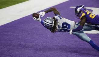 Dallas Cowboys wide receiver CeeDee Lamb (88) catches a 4-yard touchdown pass ahead of Minnesota Vikings cornerback Jeff Gladney, right, during the first half of an NFL football game, Sunday, Nov. 22, 2020, in Minneapolis. (AP Photo/Bruce Kluckhohn)