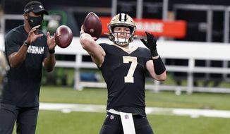 New Orleans Saints quarterback Taysom Hill (7), starting for an injured Drew Brees, warms up before an NFL football game against the Atlanta Falcons in New Orleans, Sunday, Nov. 22, 2020. (AP Photo/Butch Dill)