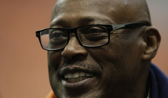 In this Nov. 30, 2013, file photo, NFL great Floyd Little talks to players on the sideline before a Syracuse against Boston College NCAA college football game in Syracuse, N.Y. Hall of Fame running back Little has entered hospice care, according to ex-Syracuse teammate Patrick Killorin. Killorin shared the update Saturday, Nov. 21, 2020, on Facebook, where he has provided periodic updates on Little's health since May when Little's bout with cancer became public. (AP Photo/Nick Lisi, File)  **FILE**